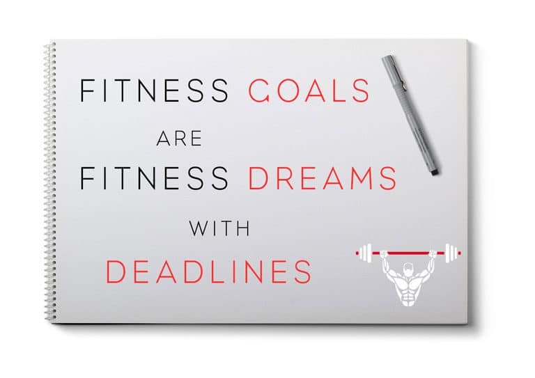 Note pad and pen with fitness goals quote